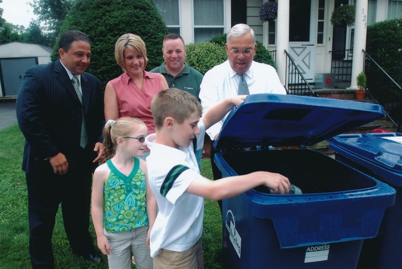 We were asked to be the first family in Hyde Park to receive a single stream recycling bin. Liam was the first to use it. Pictured, from left to right: Rob Consalvo, Janice Kenney, Larry Kenney, Mayor Thomas M. Menino, Ryleigh Kenney, and Liam Kenney. Contributor: Janice Kenney.