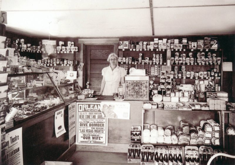 Nellie is staffing her general store on Route 6 in North Eastham. The theater posters are for Orleans Theater movies showing is September and August. Pictured: my grandmother Nellie Nickerson.
