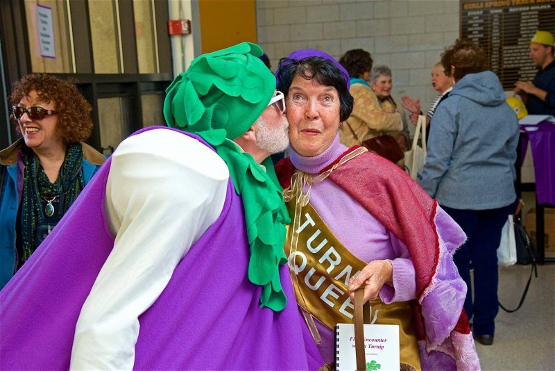 Turnip Queen 2013 is greeted by her most devoted fan. Photo taken by Anton Anderson. Pictured, from left to right: Jack Kerig and Kaye Richardson. Location: Eastham Turnip Festival at Nauset Regional High School.
