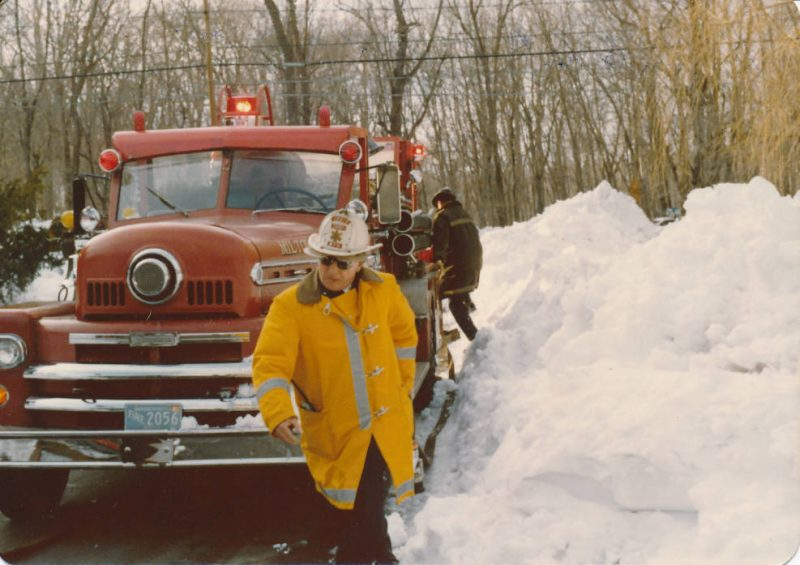 Fighting fire through the Blizzard of 1978. 'My father-in-law, Eugene H. Lorden, Jr.: Deputy Chief, coming up to a home to put out a fire in a stove. Deputy Eugene Lorden would fight through anything to help anyone. That's what impressed me about him.' Contributor: Bill Neville