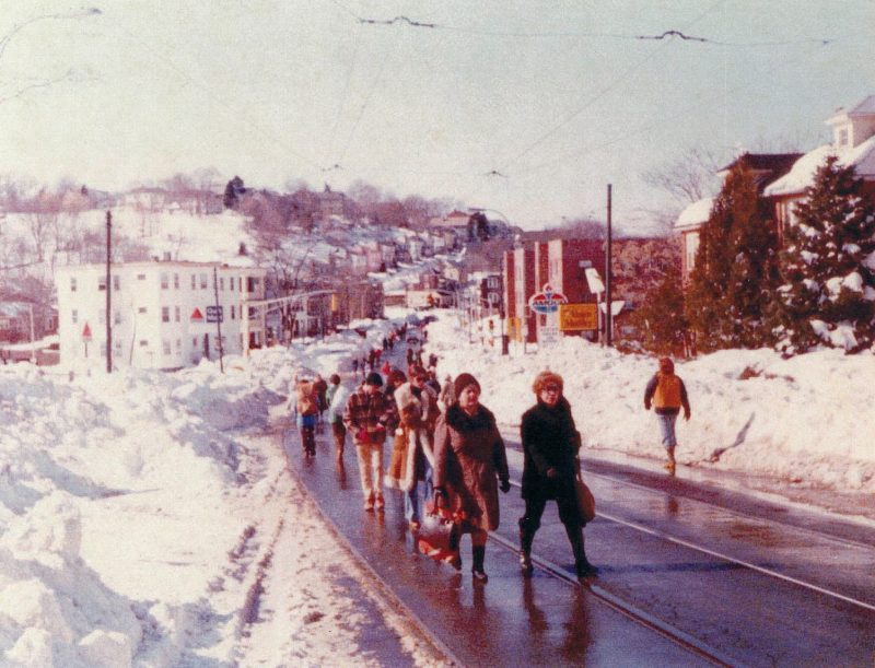 Washington Street near Lake Street, Brighton, week of the blizzard of '78. 'During the blizzard of 1978, not only was there an epic amount of snow, but it was unique for the near shutdown of the Boston region for a week. A few days after the storm I took a walk with my camera along the streets of the neighborhood, where no cars were allowed, only people.' Contributor: Charlie Vasiliades
