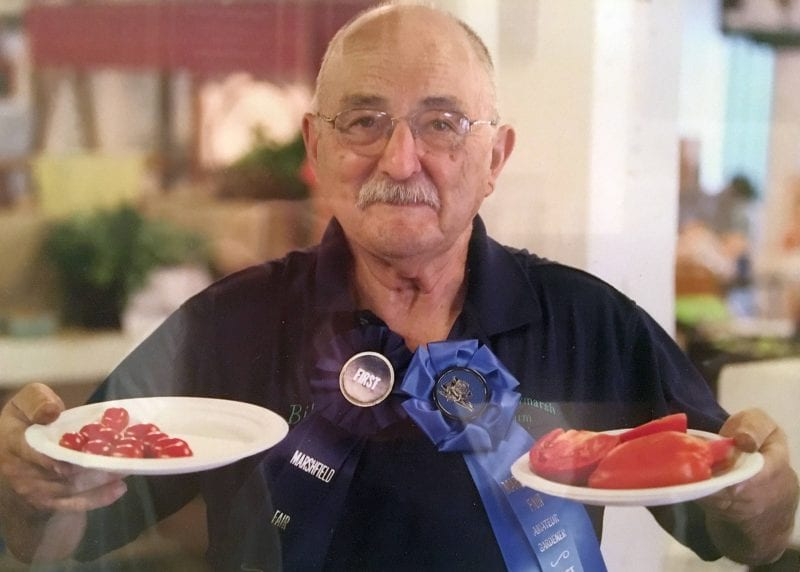'Farmer at heart, 2015. It was a tomato contest at our farmer's market. I grew these on the last colonial farm in town (Truant).' Contributor: William R. Frugoli.