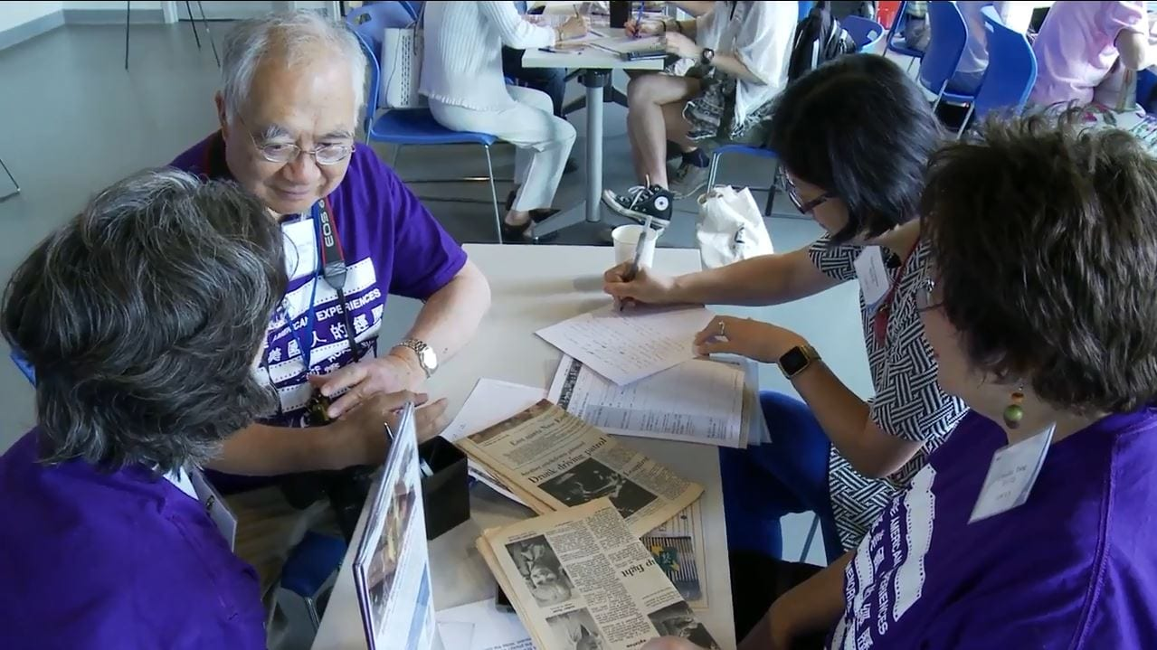 Attendees and volunteers wearing purple event t-shirts at the Chinese American Experiences Mass. Memories Road Show