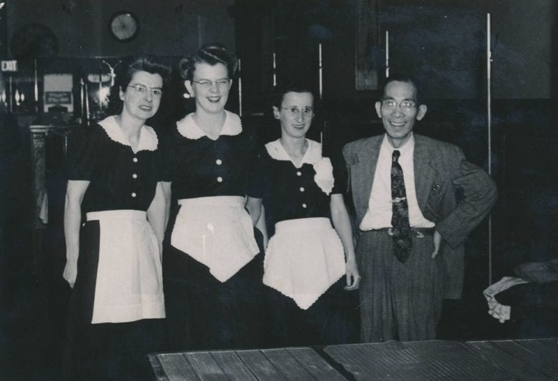 My father and his staff Description 'My father owned the Jade Restaurant in Malden. He purchased it during WWII and expanded it. He had several wait staff and kitchen staff. Pictured, from left to right: Maude McKenzie, the wait staff at Jade Restaurant, my father Dun Shai Jeong. Location: Jade Restaurant.'