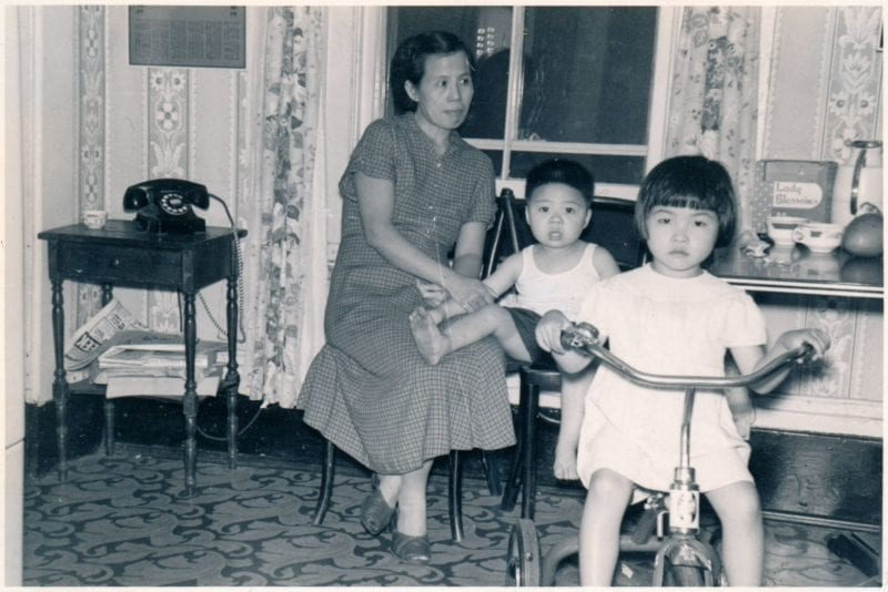 Inside 116 Hudson Street circa 1954 Description 'This was taken inside 116 Hudson Street, 2nd floor, in the 1950s when Chinese-American (Taishanese American) families formed for the first time. Settling on Hudson Street until Hudson Street was demolished in 1963 for the Southeast Expressway ramp. It was a traumatic displacement for the immigrants who had been displaced through immigration, revolution, and war. Pictured, from left to right: May Soon Yee, Albert Yee, and Cynthia Yee.'