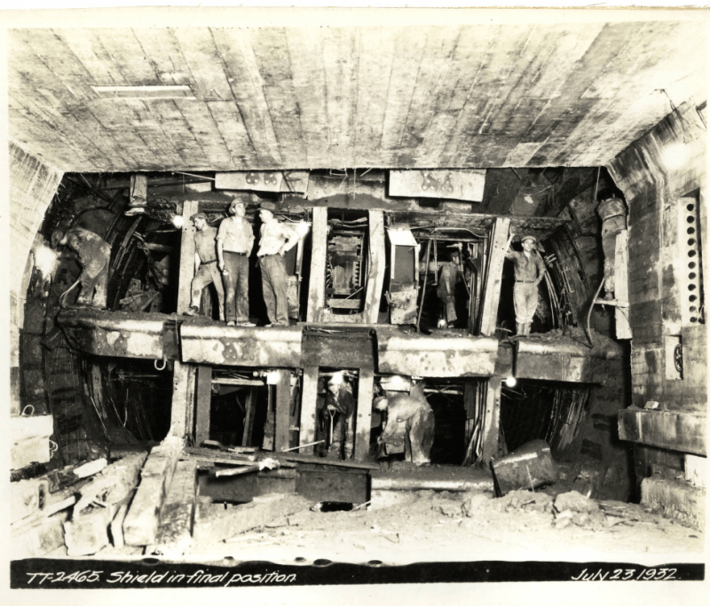 Black-and-white photo of workers standing inside Sumner Tunnel