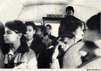 Black and white photographs shows students seated on a schoolbus and the schoolbus emergency exit sign.