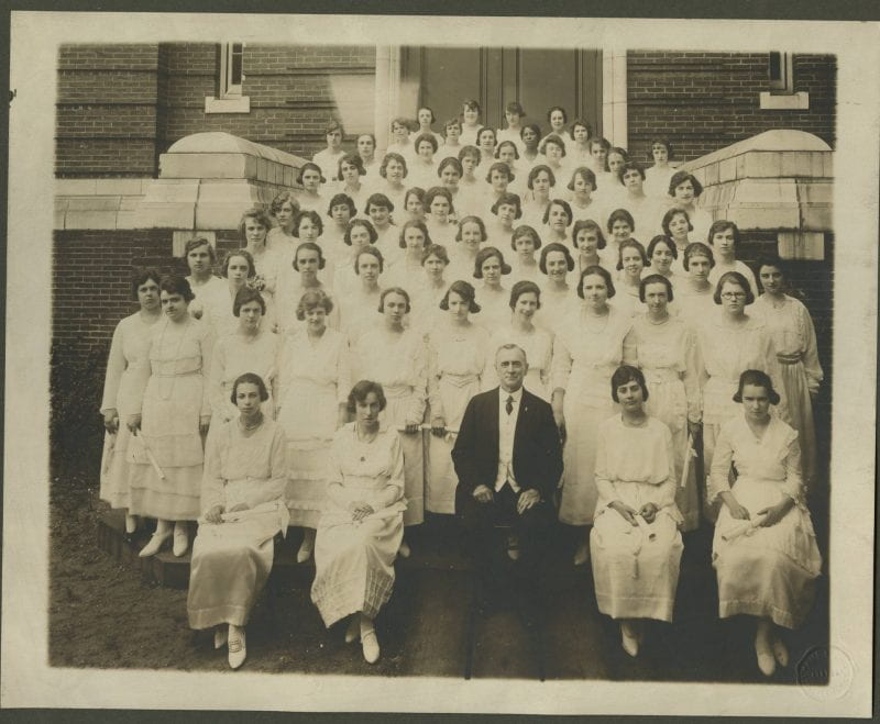 Black-and-white group photo of Boston Normal School students outside of a school building