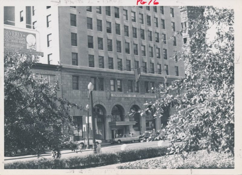 Black-and-white photo of the front of UMass Boston's main building in Park Square