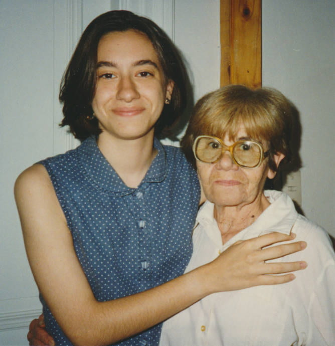 Photograph of a grandmother and granddaughter embracing