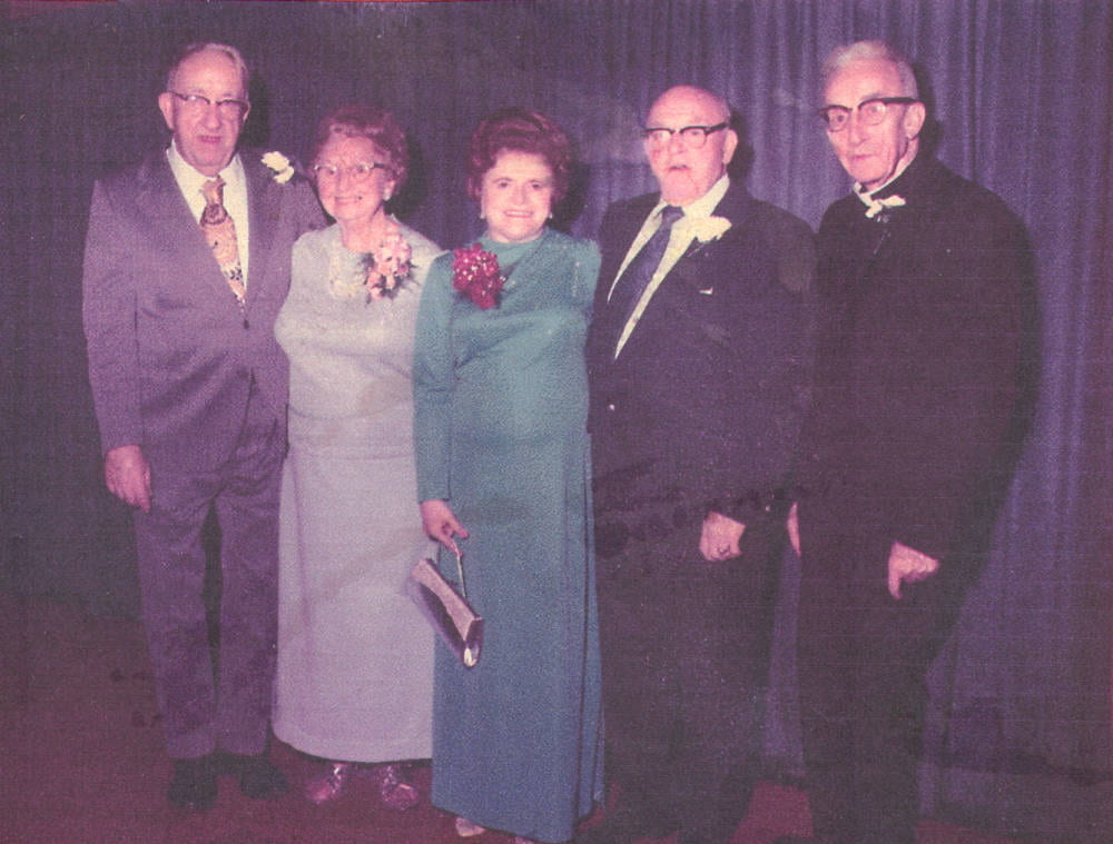Photo from the Norwood Mass. Memories Road Show showing 5 people.