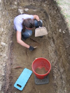 Uncovering the top of the largest of the mystery artifacts.