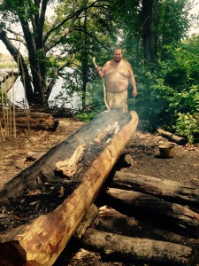 A Wampanoag making a mishoon -- or dugout boat.