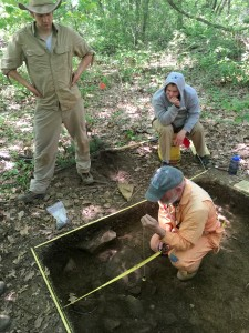 Dr. Mrozowski shows some of his field students how to map a feature.