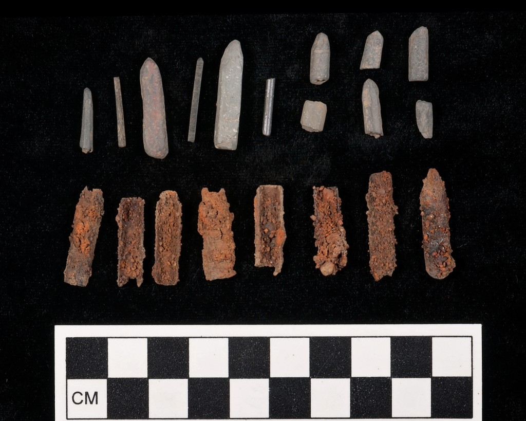 Slate pencil fragments, pencil leads, and pen nibs from EU7, Burial Hill, Plymouth.