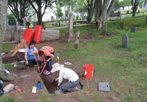 Caroline, Anna, and Samantha work on one of the units on Burial Hill.