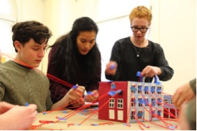 Students attaching yarn sight lines to model of the Royall mansion as a way to help them understand historical landscapes and uses.