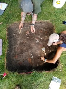 Overhead view of two students excavating.