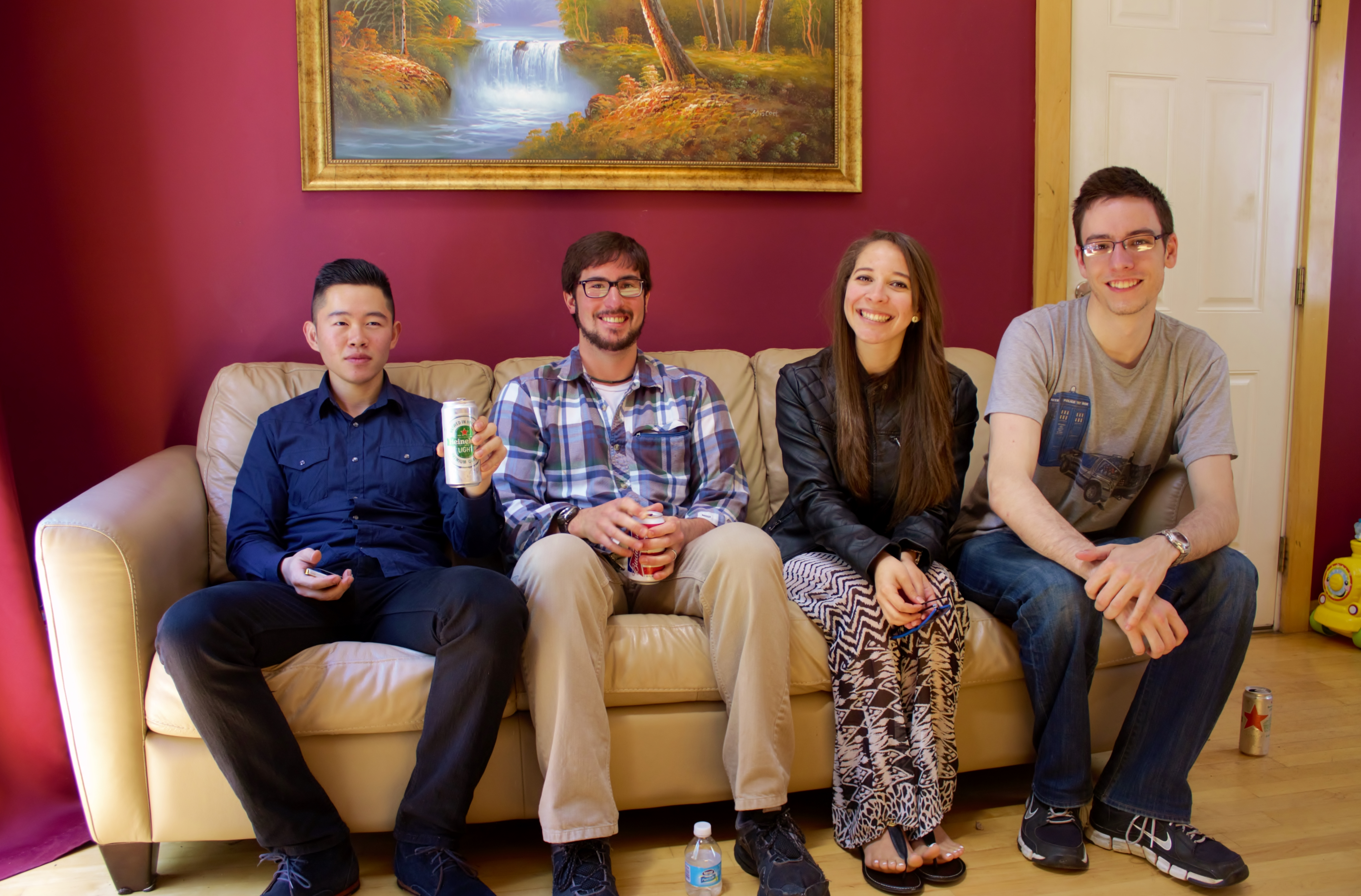 From left to right: Zhi, Andrew, Steph, and Julian relax on the couch after a big meal.