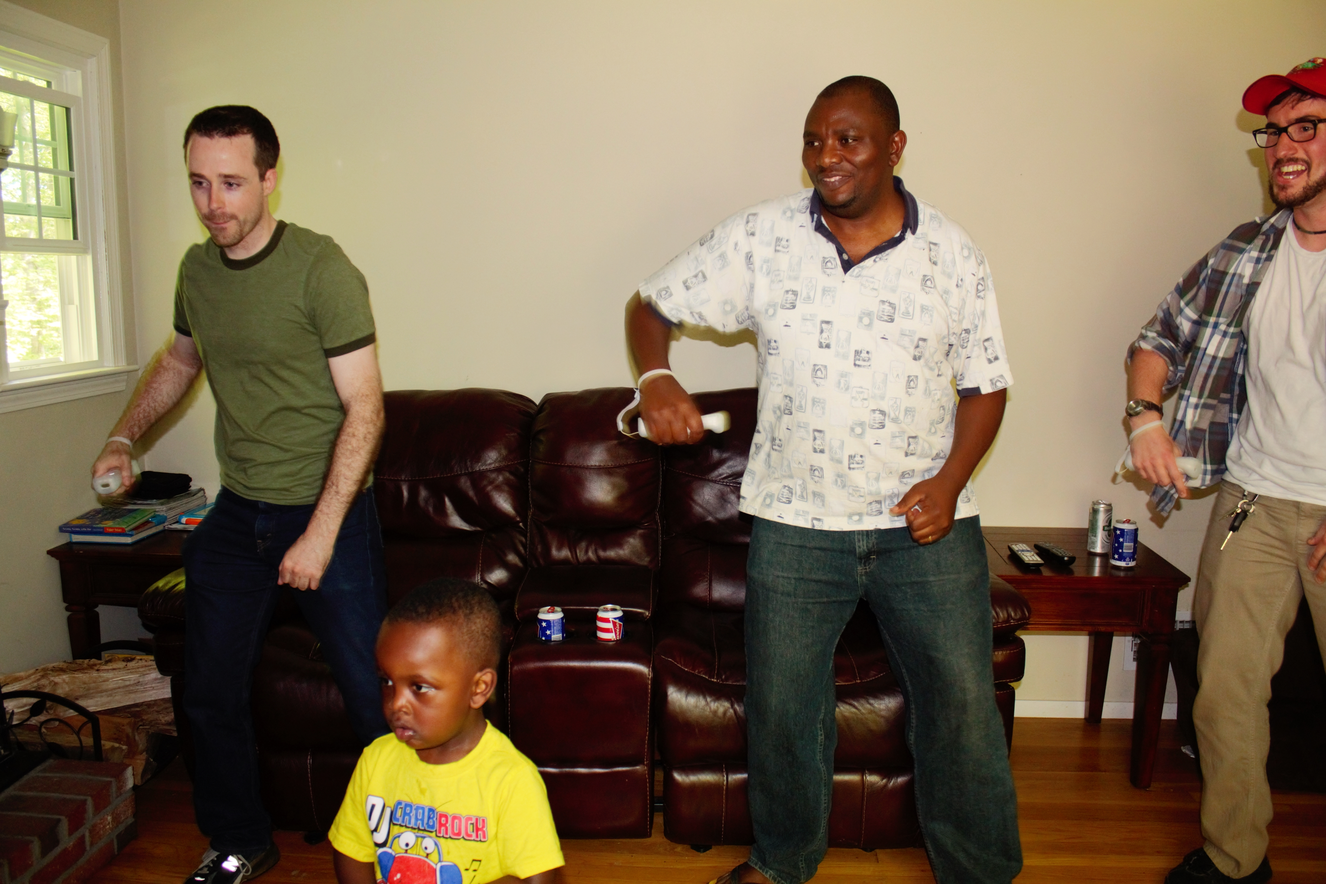 From left to right: Ian, Lenny, Martin and Andrew play Wii games.