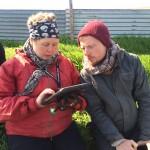 Guðný and Eric using an iPad