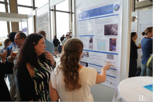 Amy explaining her results to her adviser - Dean Hannigan - at the poster session in Prague (Photo by Steven Nye)