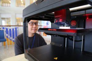 Student looking at printer