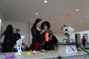students looking at robot