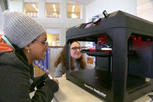 Student looking at print