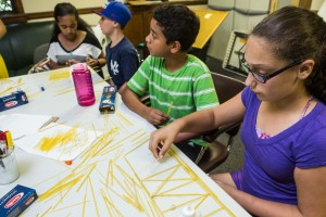Students designing spaghetti bridges