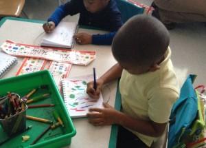 Kindergartener journaling in Daron Cyr's class