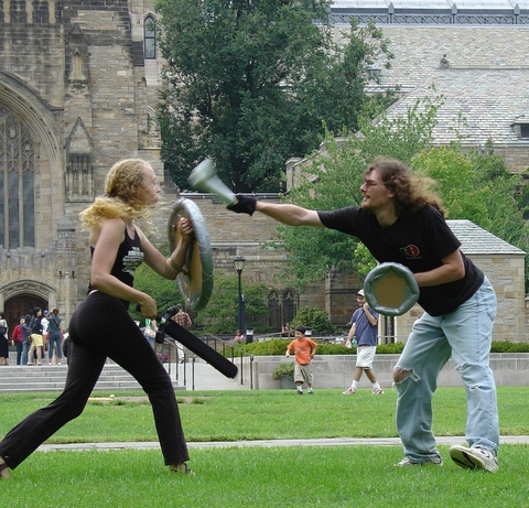 Different male and female student dueling.