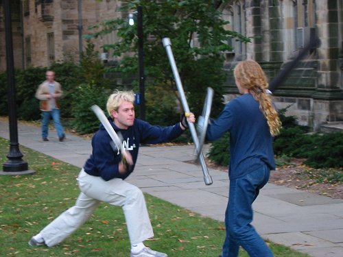 Male and female students dueling.