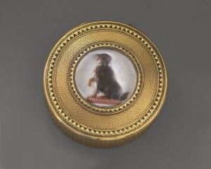 image of round gold snuffbox with wax portrait of a dog