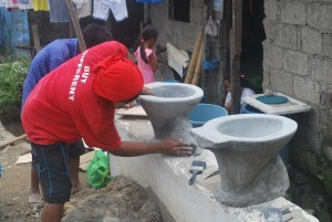 Relief workers build toilets in an effort to improve sanitation before the start of monsoon season.