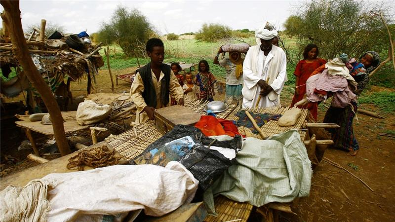 Family Flees Flooded Village in Sudan