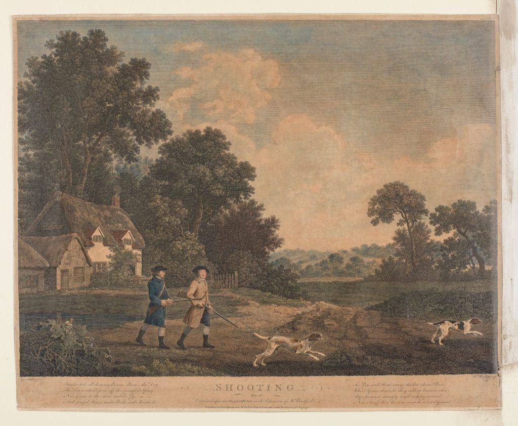 Two men armed with guns walk towards a field across from a thatched cottage