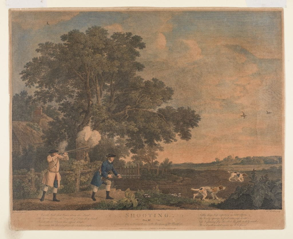 Two men hunt in the field across from a thatched cottage
