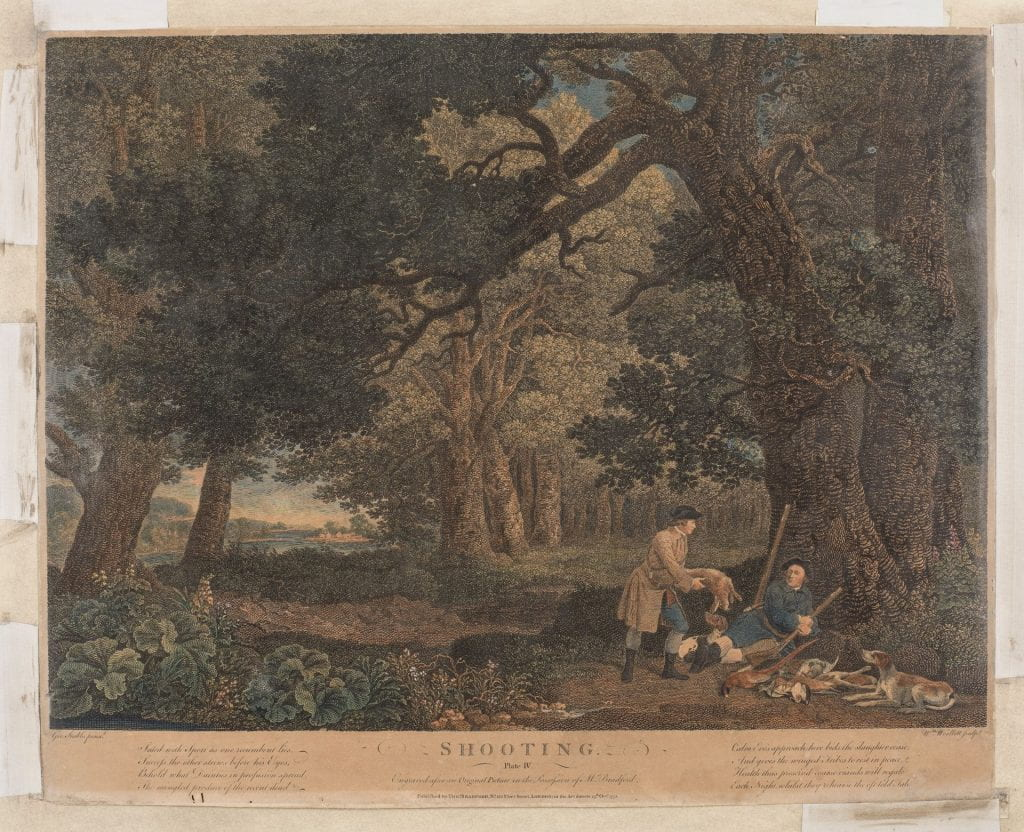 In a dense forest, two men with hounds rest by a tree