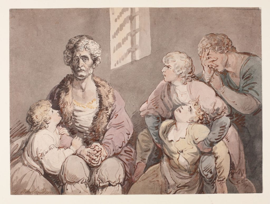 man with children in prison cell