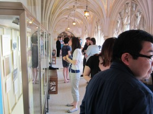 Student Research Exhibit reception attendees in the corridor at Sterling Memorial Library, 13 May 2015.