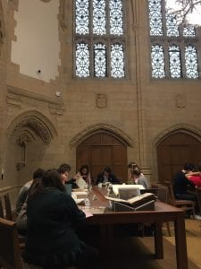 Students in Prof. Jay Gitlin's Yale and America class exploring Manuscripts and Archives collection materials in the Gates Classroom.