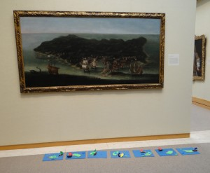 Our islands below the painting in the galleries.