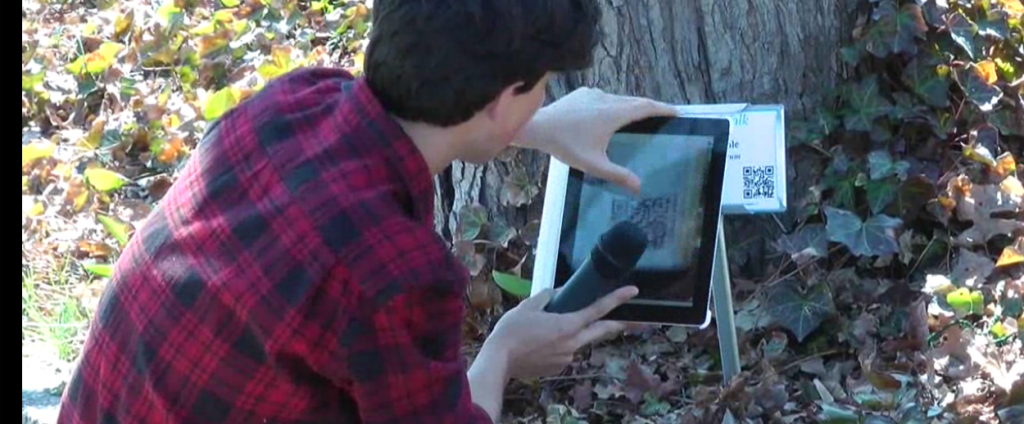 A student demonstrates the use of QR codes to access the Yale NatureWalk site