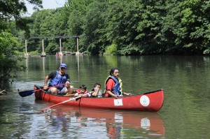 Community members paddling at the 2008 Bronx River Festival. 2000 people, including 800 students, participated in canoe tours in 2013. Photo courtesy of Bronx River Alliance.