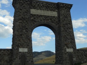 Arch at Yellowstone National Park with the well-known saying. Photo courtesy of Madeline Hirshan