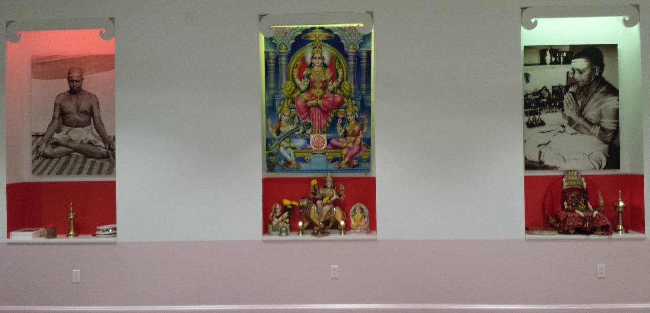 Figure 2 - East wall of the AYNY and Broome Street Temple. (Left) Sri Patabhi Jois in padmasana or lotus position. (Center) Image the Goddesses: Durga, Lakshmi, and Saraswathi. (Right) Sri Pattabhi Jois performing ritual prayer.