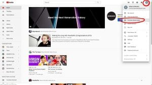 YouTube Homepage with circles on User Icon and YouTube Studio Beta