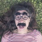 Photo of woman wearing Grouch Mark glasses and mustache