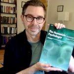 Raskin holding The Humanistic Psychologist